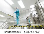 factory worker in blue suit... | Shutterstock . vector #568764769