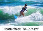 riding the waves. hermosa beach ... | Shutterstock . vector #568776199