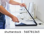using scanner in office or... | Shutterstock . vector #568781365