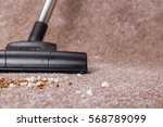 vacuuming carpet with vacuum... | Shutterstock . vector #568789099