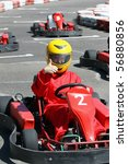 a smiling young  racer shows ok.... | Shutterstock . vector #56880856