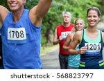 marathon male athlete crossing... | Shutterstock . vector #568823797