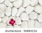 Stock photo red petals on white pebble background relaxation and meditation concept 56884216