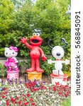 Small photo of OSAKA, JAPAN - NOV 21 2016: Elmo, Kitty and Snoopy in Halloween costume statues in Universal Studios japan