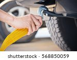 hand holding yellow car towing... | Shutterstock . vector #568850059