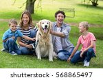 family with dog in the park on... | Shutterstock . vector #568865497