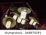 fluorescent lamps hanging over... | Shutterstock . vector #568870291