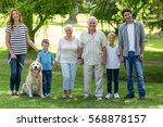 family with dog in the park on... | Shutterstock . vector #568878157