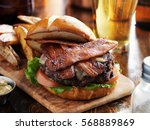 bacon burger with pretzel bun... | Shutterstock . vector #568889869