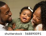 happy family.  new parents. | Shutterstock . vector #568890091