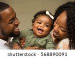 happy family.  new parents. | Shutterstock . vector #568890091