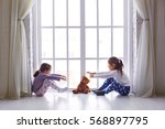 two little girls playing with a ... | Shutterstock . vector #568897795
