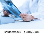 woman doctor looking at x ray... | Shutterstock . vector #568898101
