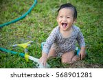 little baby boy playing with... | Shutterstock . vector #568901281