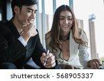 portrait of two business people ...   Shutterstock . vector #568905337
