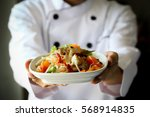 chef proudly presenting thai... | Shutterstock . vector #568914835