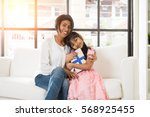 indian mother and daughter... | Shutterstock . vector #568925455