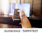 hand holding use remote control ... | Shutterstock . vector #568947829