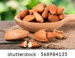 heap of peeled almonds in a... | Shutterstock . vector #568984135