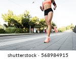 athletic woman running on... | Shutterstock . vector #568984915