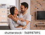 beautiful couple hugging and... | Shutterstock . vector #568987891