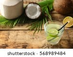 glass of coconut water with... | Shutterstock . vector #568989484