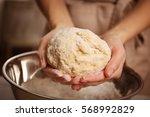 Young Woman Making Dough In...