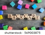 Small photo of Wooden cubes with word BACKCARE on table