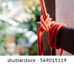 The Knot Of Red Rope Is Tied O...