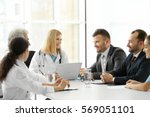 team of doctors having meeting... | Shutterstock . vector #569051101