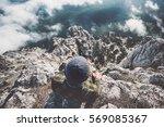 man relaxing alone on rocky... | Shutterstock . vector #569085367