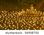 Buddha Statue And Candle In...