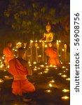 Monk Pray To Buddha Statue And...