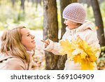 young mother playing with her... | Shutterstock . vector #569104909