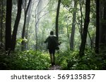 man hiking in the woods after... | Shutterstock . vector #569135857