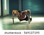 young stron man is doing push... | Shutterstock . vector #569137195
