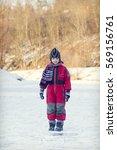 Child Walking On Frozen River...