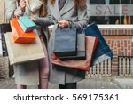 two girls with shopping bags in ... | Shutterstock . vector #569175361