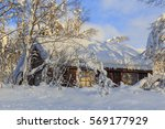 snow covered wooden hut in... | Shutterstock . vector #569177929