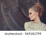 gorgeous woman in in a stylized ... | Shutterstock . vector #569181799