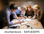 group of designers working on a ... | Shutterstock . vector #569183095