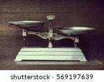 vintage balance on wood... | Shutterstock . vector #569197639