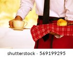 waiter is serving coffee and... | Shutterstock . vector #569199295