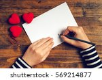 Stock photo woman writing love letter or romantic poem for valentines day top view of female hands 569214877