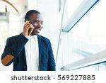 african man talking on mobile... | Shutterstock . vector #569227885