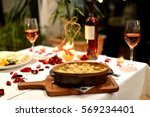 romantic dinner with food and... | Shutterstock . vector #569234401