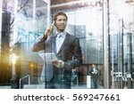 businessman talking on the... | Shutterstock . vector #569247661