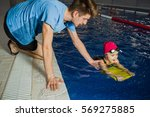 Instructor Teaches The Child T...