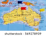 Small photo of Map of Australia with Pushpins on it, shallow focus