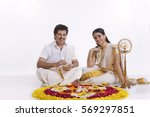 couple celebrating onam | Shutterstock . vector #569297851